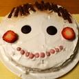 似顔絵の誕生日ケーキ
